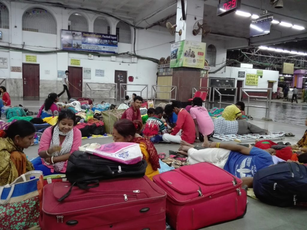 People sleeping on the floor in Kolkata train station